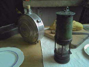 Miner's lamp, flask and snap tin