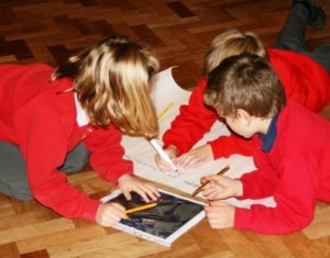 Pupils look at images of town sites and work on ideas