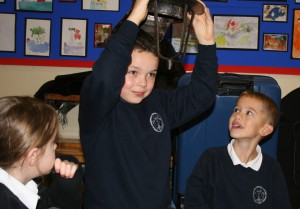 Pupils handle a replica helmet.