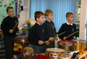 Pupils try out rhythms with drums