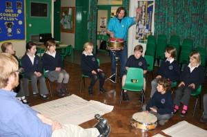 Pupils perform the final song with Victor Scott on drums.