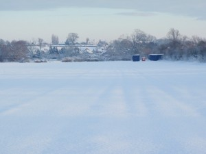 The site huts under snow, Marton is in the background.